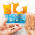 Elderly woman taking medication from pill box - AGS Beer Criteria