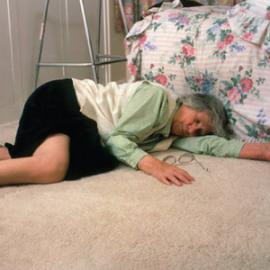 elderly woman after having fallen down